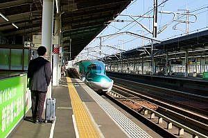 Bullet Train Arriving in a Station in Japan