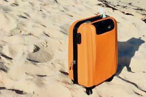 Hand Luggage on Beach