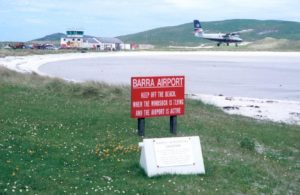 A plane landing at Barra International Airport in Scotland.