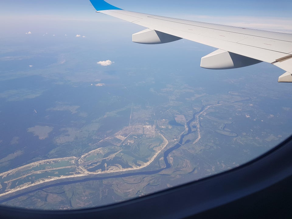 Photo out of a plane window of the Chernobyl 30km exclusion zone