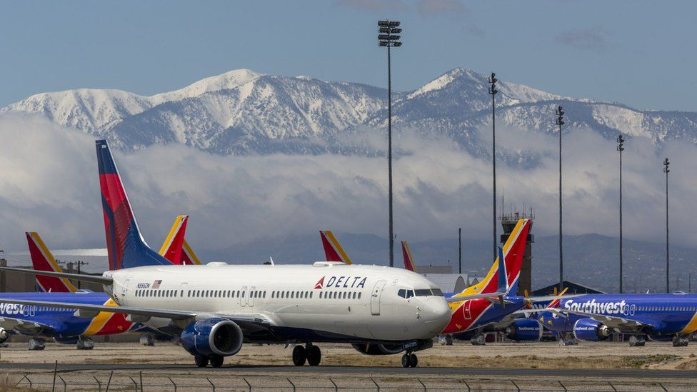 Delta airplane with mountain background