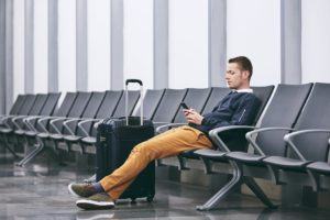 Passenger waiting to fly inside airport terminal