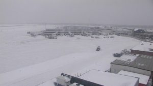 Snow covers the runway