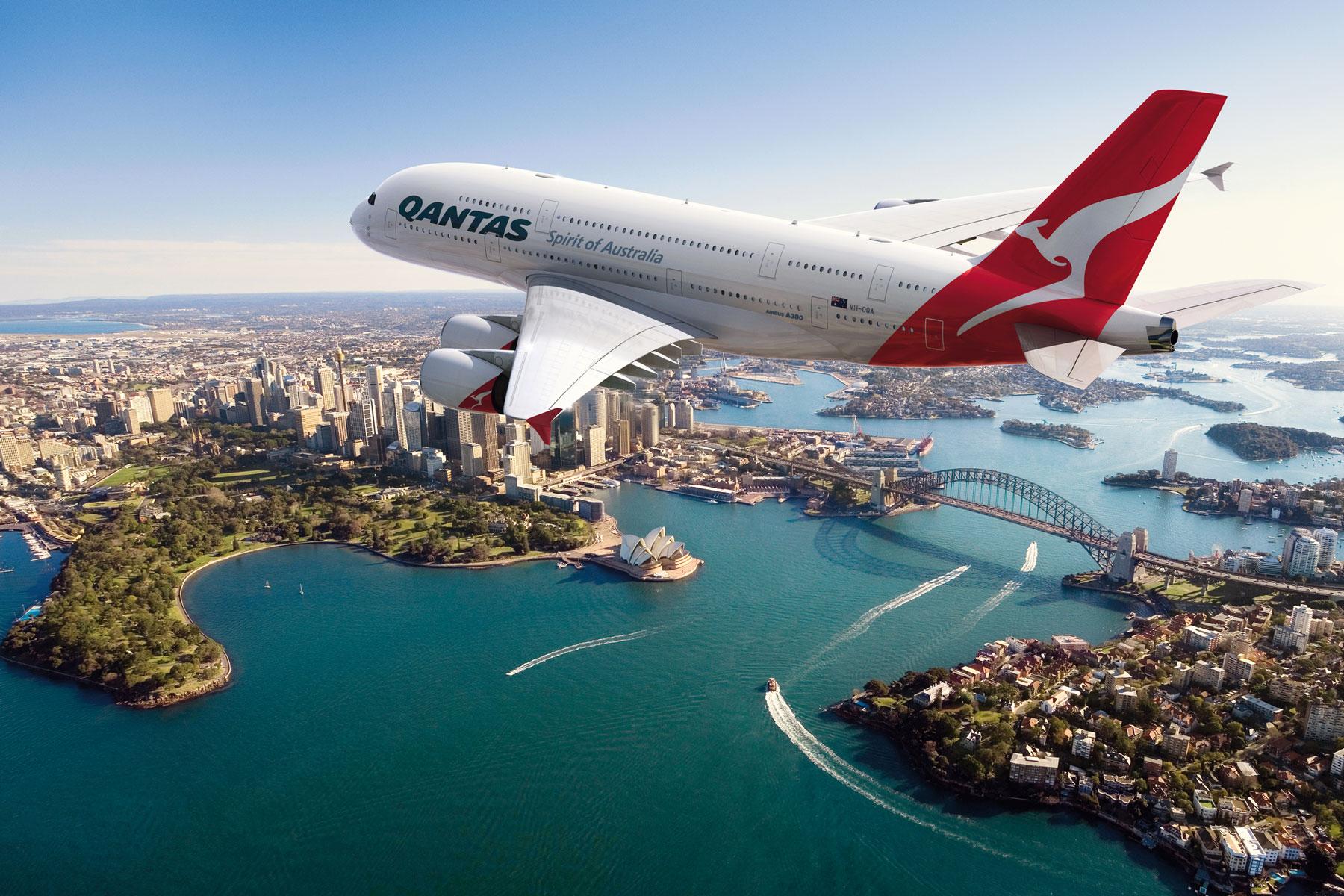 Qantas jet flying over iconic Sydney harbour bridge