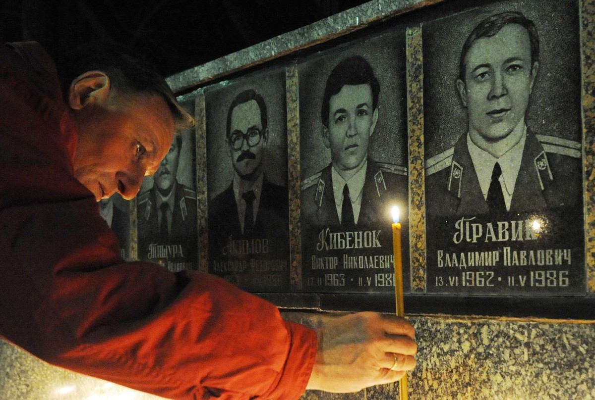 Man pays respect to the hero's of Chernobyl by lighting a candle at the Chernobyl victims' monument in Slavutich