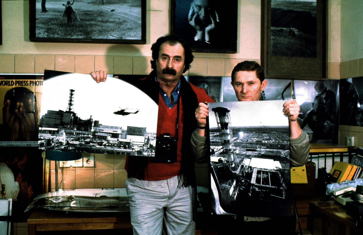 Two brave photographers posing iwth their famous photographs taken from a helicopter over Chernobyl Nuclear Power plant
