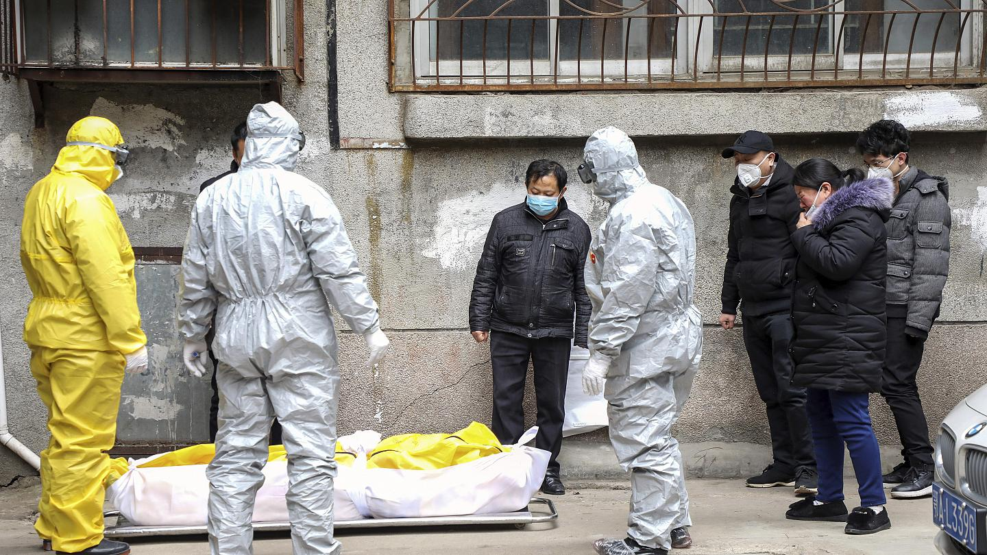 a man suspected of dying from Covid19 in is home in a residential block in Wuhan