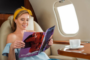 Woman reading inflight magazine