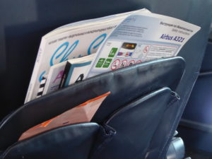 Inflight magazine stored in seat pocket holders