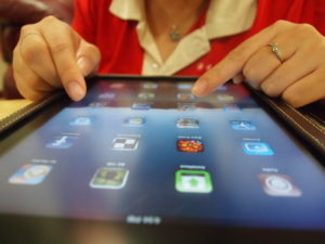 Image of woman using a tablet