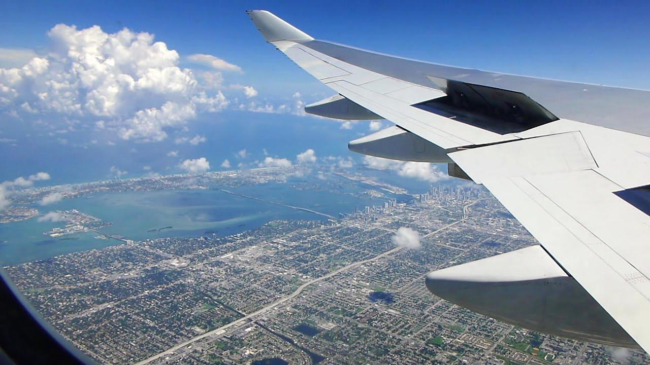Plane flying over Miami heading into Miami International airport
