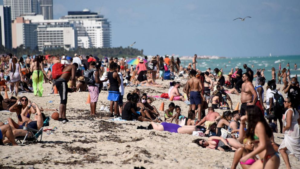 Party-goers lining Miami Beach despite the ongoing pandemic