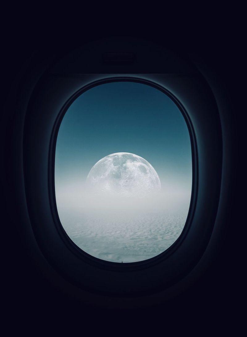 Super moon as seen through plane window