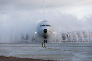 Boeing plane going through a rinse system to remove saltwater