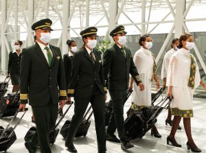Cabin Crew and Pilots walking through an airport