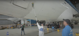 KLM maintenance cleaning crew cleaning parts of a KLM aircraft