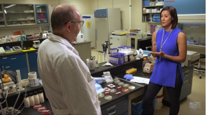CBC inside a lab with Microbiologist discussing the pathogens found.