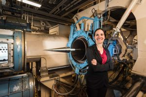 Woman stands next to hypersonic aircraft engine
