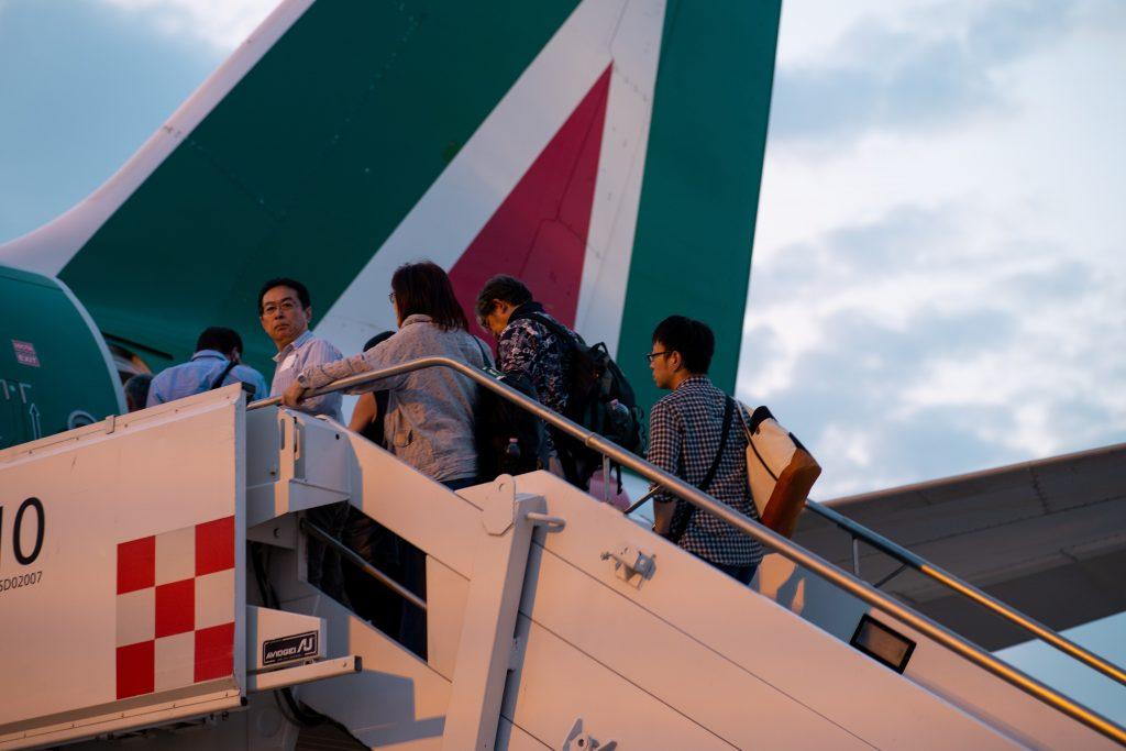 Passengers boarding an Alitalia flight. Photo by Marcel Pirnay
