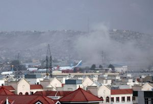 Smoke rises from Kabul Airport after a large explosion at the Abbey Gate following several western agencies reporting a terrorist threat just hours earlier