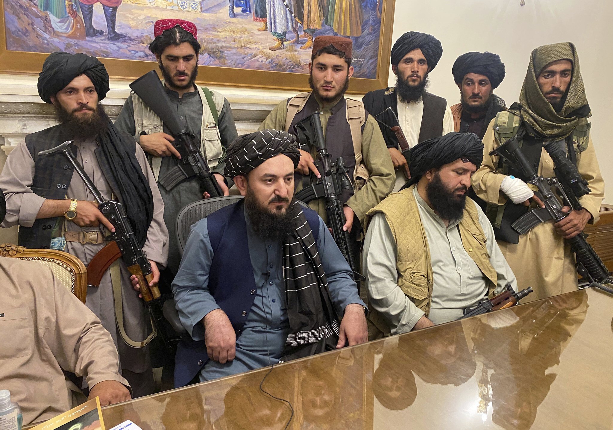 Taliban fighters take control of Afghan presidential palace after the Afghan President Ashraf Ghani fled the country, in Kabul, Afghanistan.
