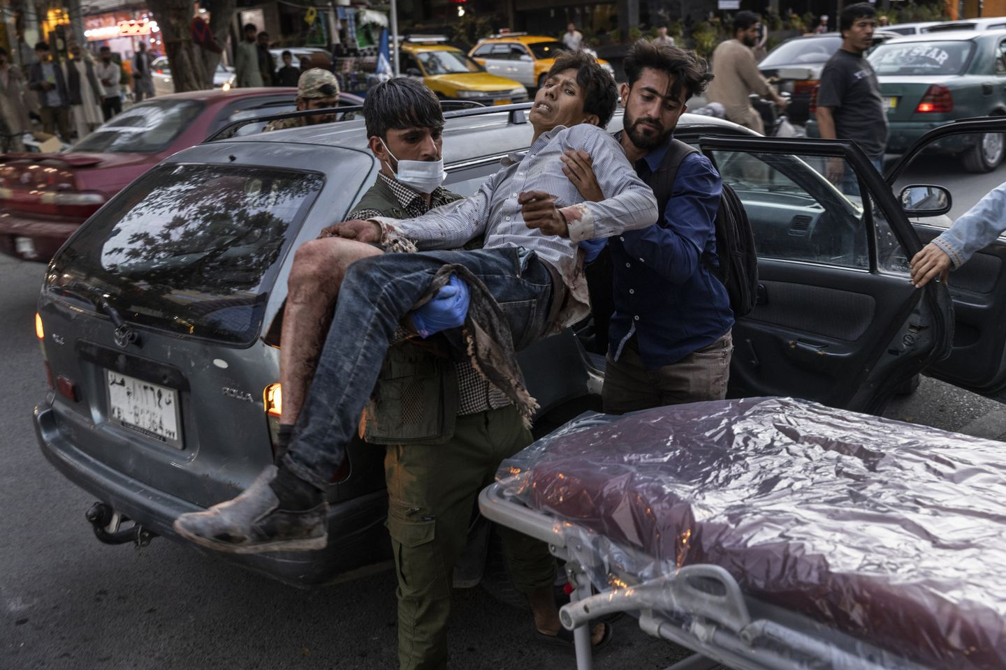 A person wounded in a bomb blast outside the Kabul airport in Afghanistan on Thursday arrived at a hospital in Kabul