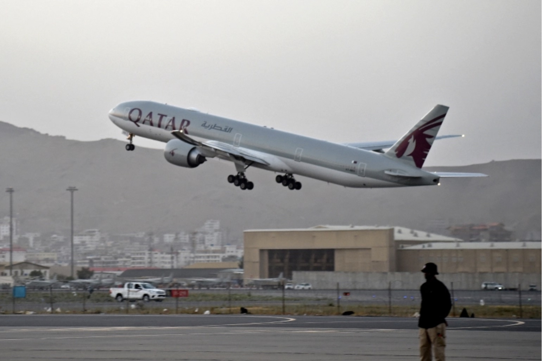 Showing Qatar Airways plane departing